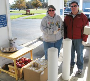 L to R, Operations Manager Denise Dube and Loan Officer Jason Hilt serving the drive up Members.